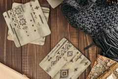Autumn composition. Cup of tea, women fashion scarf, gift box, firewood on wooden background. Flat lay, top view, copy space. Scandinavian hygge concept.